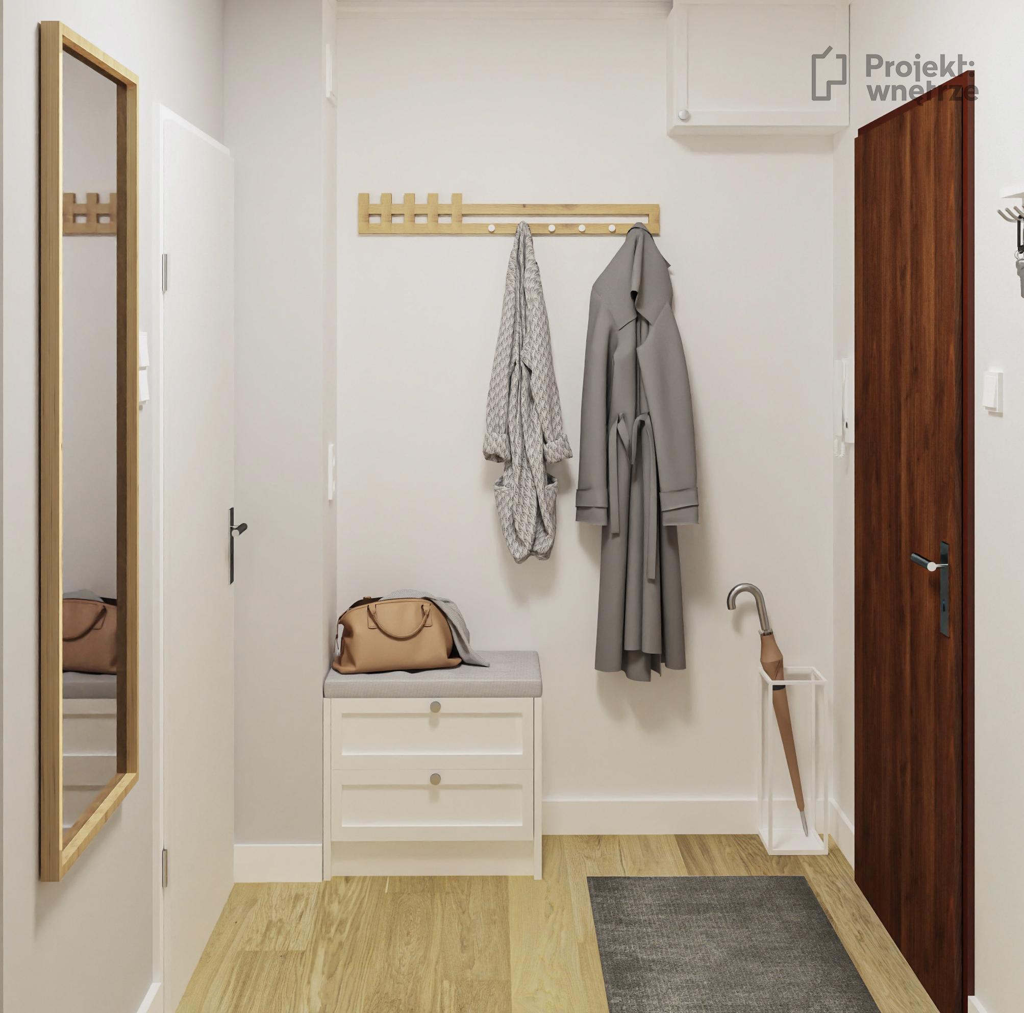 Korytarz białe meble drewno Projekt wnętrze projekt małego mieszkania w neutralnych odcieniach szarości biel drewno. Lamele w salonie. Mały salon z aneksem kuchennym i miejscem do pracy - projektowanie wnętrz warszawa online - www.projektwnetrze.com.pl