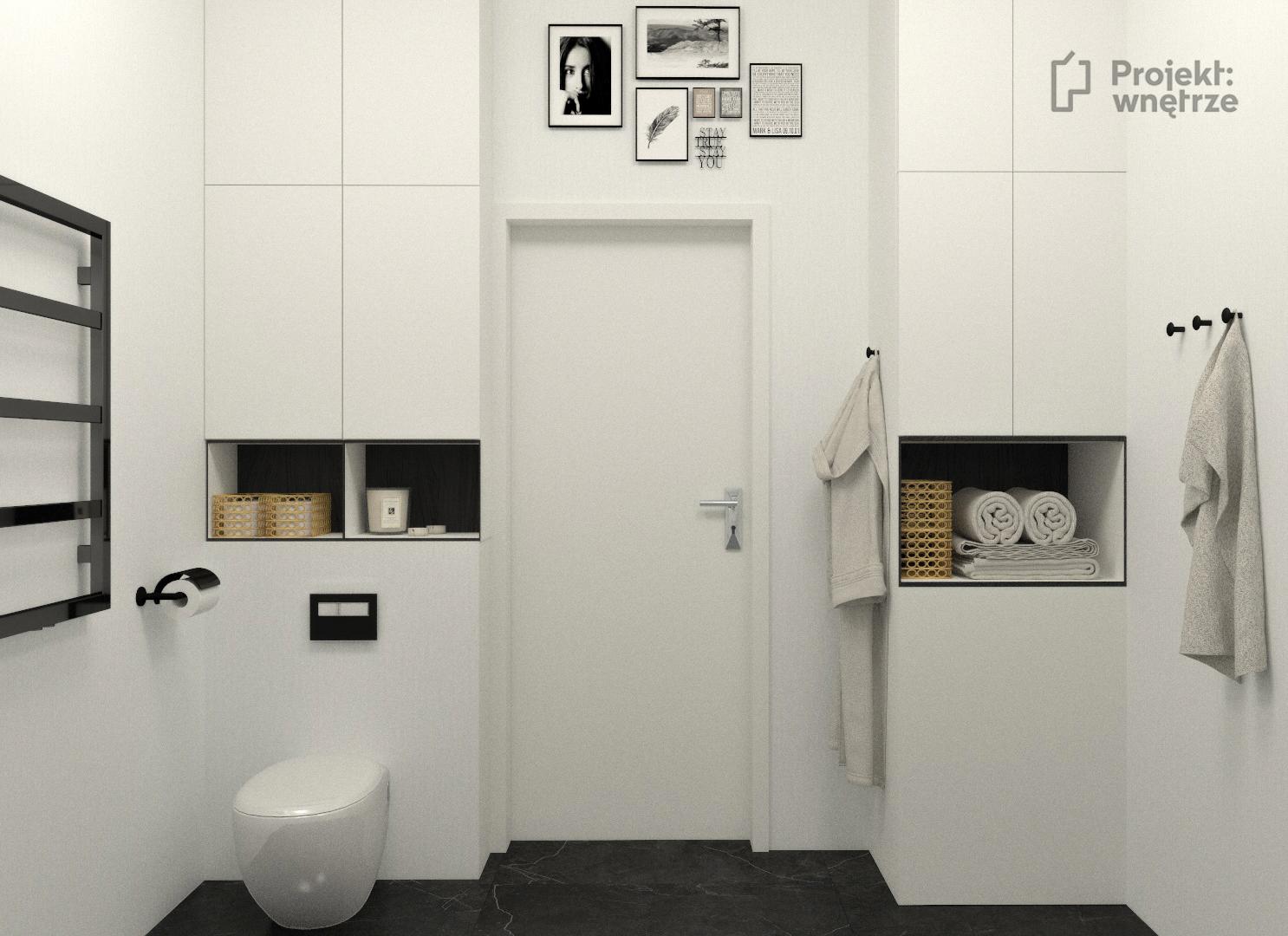 Projekt wnetrze biało czarna łazienka w bloku zabudowa